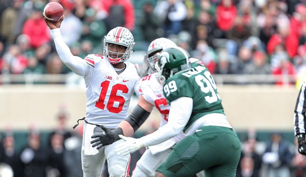 Nov 19, 2016; East Lansing, MI, USA; Ohio State Buckeyes quarterback J.T. Barrett (16) throws the ball against the Michigan State Spartans during the first quarter of  a game at Spartan Stadium. Photo Credit: Mike Carter-USA TODAY Sports