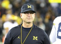 Michigan signs Harbaugh to four-year extension