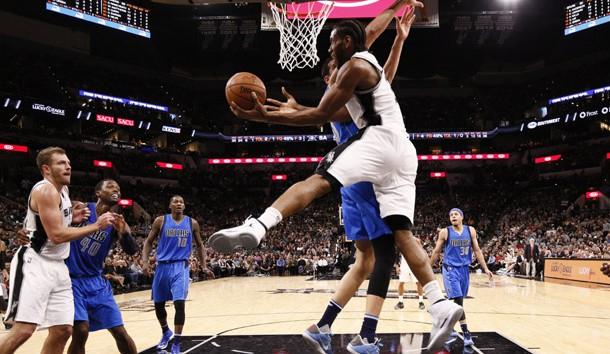 Mavericks' upset bid denied by Spurs in crunch time