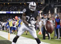 Murray scores 3 TDs as Raiders romp past Broncos