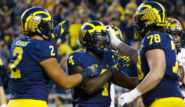 Nov 5, 2016; Ann Arbor, MI, USA; Michigan Wolverines running back De'Veon Smith (4) receives congratulations from tight end Devin Asiasi (2) and offensive lineman Erik Magnuson (78) after scoring a touchdown in the second half against the Maryland Terrapins at Michigan Stadium. Michigan 59-3. Photo Credit: Rick Osentoski-USA TODAY Sports