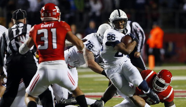 Nov 19, 2016; Piscataway, NJ, USA; Penn State Nittany Lions running back Saquon Barkley (26) rushes against Rutgers Scarlet Knights defensive back Anthony Cioffi (31) during first half at High Points Solutions Stadium. Photo Credit: Noah K. Murray-USA TODAY Sports