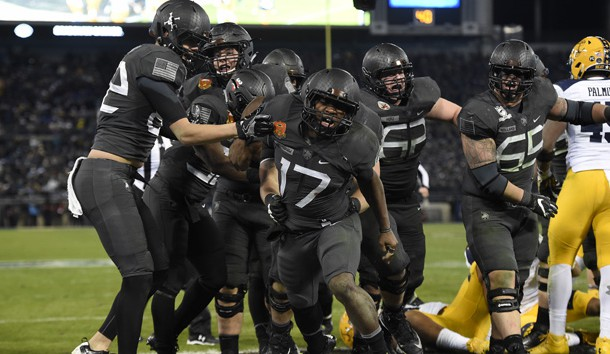 Dec 10, 2016; Baltimore, MD, USA; Army Black Knights quarterback Ahmad Bradshaw (17) celebrates with teammates after scoring a touchdown during the fourth quarter of the 117 annual Army Navy game against the Navy Midshipmen at M&T Bank Stadium. Army Black Knights defeated Navy Midshipmen 21-17. Mandatory Credit: Tommy Gilligan-USA TODAY Sports