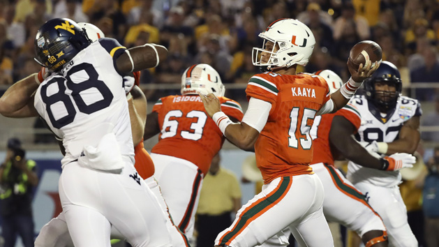 Miami blows past WVU in Russell Athletic Bowl