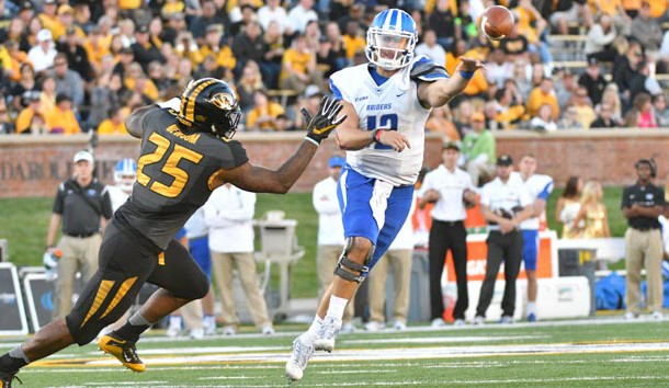 Oct 22, 2016; Columbia, MO, USA; Middle Tennessee Blue Raiders quarterback Brent Stockstill (12) throws a pass as Missouri Tigers linebacker Donavin Newsom (25) pressures during the second half at Faurot Field. Middle Tennessee won 51-45. Photo Credit: Denny Medley-USA TODAY Sports