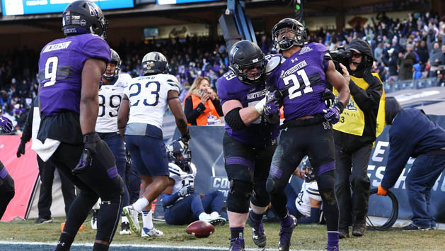 Jackson leads Northwestern to win at Pinstripe Bowl