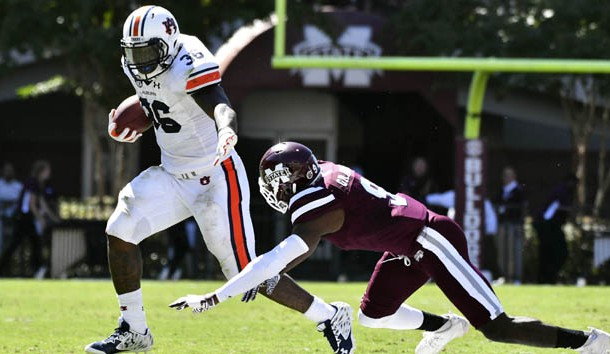 Oct 8, 2016; Starkville, MS, USA; Auburn Tigers running back Kamryn Pettway (36) runs the ball as he is defended by Mississippi State Bulldogs defensive back Jamoral Graham (9) during the second quarter of the game at Davis Wade Stadium. Photo Credit: Matt Bush-USA TODAY Sports