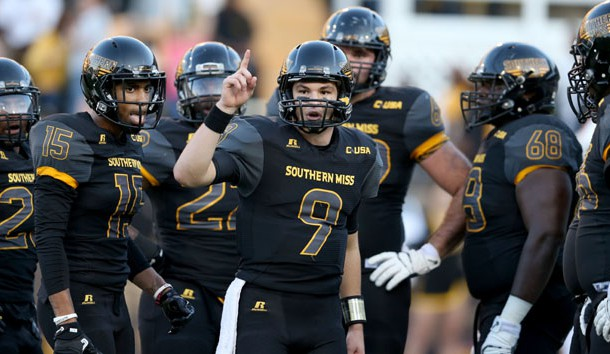 Nov 25, 2016; Hattiesburg, MS, USA; Southern Miss Golden Eagles quarterback Nick Mullens (9) gestures during their game against the Louisiana Tech Bulldogs in the second quarter at M.M. Roberts Stadium. Photo Credit: Chuck Cook-USA TODAY Sports
