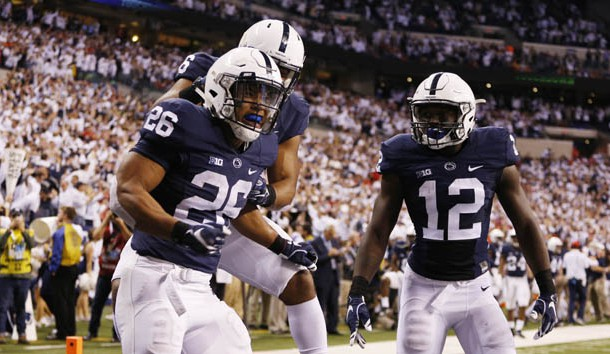 Dec 3, 2016; Indianapolis, IN, USA; Penn State Nittany Lions running back Saquon Barkley (26) celebrates with teammates after catching a touchdown pass against the Wisconsin Badgers in the second half during the Big Ten Championship college football game at Lucas Oil Stadium. Photo Credit: Brian Spurlock-USA TODAY Sports