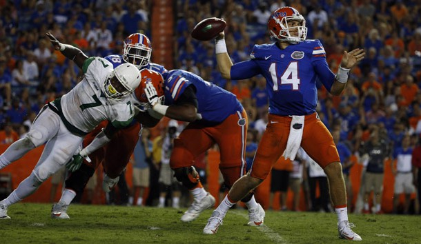 Sep 17, 2016; Gainesville, FL, USA;  Florida Gators quarterback Luke Del Rio (14) thows the ball as North Texas Mean Green defensive end Jareid Combs (7) rushes during the second half at Ben Hill Griffin Stadium. Florida Gators defeated the North Texas Mean Green 32-0. Photo Credit: Kim Klement-USA TODAY Sports