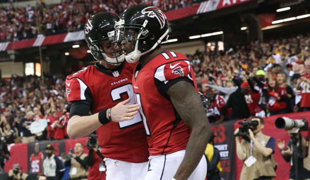 Jan 22, 2017; Atlanta, GA, USA; Atlanta Falcons wide receiver Julio Jones (11) scores a touchdown and is congratulated by quarterback Matt Ryan (2) during the third quarter against the Green Bay Packers  in the 2017 NFC Championship Game at the Georgia Dome. Photo Credit: Jason Getz-USA TODAY Sports