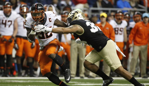 Dec 29, 2016; San Antonio, TX, USA; Oklahoma State Cowboys running back Chris Carson (32) runs the ball against the defense of Colorado Buffaloes linebacker Rick Gamboa (32, right) during the second half at Alamodome. Photo Credit: Soobum Im-USA TODAY Sports