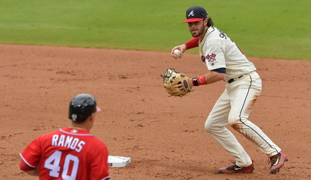 Sep 18, 2016; Atlanta, GA, USA; Atlanta Braves shortstop Dansby Swanson (2) turns a double play past Washington Nationals catcher Wilson Ramos (40) during the fifth inning at Turner Field. Photo Credit: Dale Zanine-USA TODAY Sports
