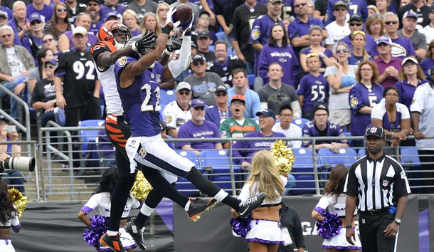 Sep 27, 2015; Baltimore, MD, USA; Baltimore Ravens cornerback Jimmy Smith (22) intercepts the ball in front of Cincinnati Bengals wide receiver A.J. Green (18) during the third quarter at M&T Bank Stadium. Photo Credit: Tommy Gilligan-USA TODAY Sports
