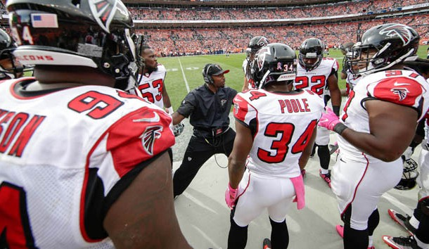 Oct 9, 2016; Denver, CO, USA; Atlanta Falcons secondary coach Marquand Manuel talks with defensive back Brian Poole (34) and defensive end Tyson Jackson (94) and teammates in the second quarter against the Denver Broncos at Sports Authority Field at Mile High. The Falcons won 23-16. Photo Credit: Isaiah J. Downing-USA TODAY Sports