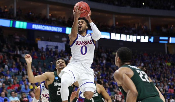 Mar 19, 2017; Tulsa, OK, USA; Kansas Jayhawks guard Frank Mason III (0) goes up for a shot as Michigan State Spartans guard Miles Bridges (22) guards during the first half in the second round of the 2017 NCAA Tournament at BOK Center. Photo Credit: Brett Rojo-USA TODAY Sports