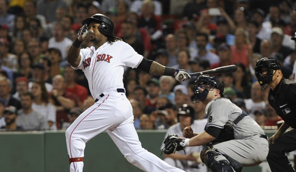 Sep 18, 2016; Boston, MA, USA; Boston Red Sox first baseman Hanley Ramirez (13) hits a three run home run during the fifth inning against the New York Yankees at Fenway Park. Photo Credit: Bob DeChiara-USA TODAY Sports