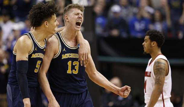 Mar 19, 2017; Indianapolis, IN, USA; Michigan Wolverines forward Moritz Wagner (13) and forward D.J. Wilson (5) celebrate during the second half in the second round of the 2017 NCAA Tournament against the Louisville Cardinals at Bankers Life Fieldhouse. Photo Credit: Brian Spurlock-USA TODAY Sports