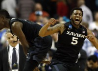 Zags hold off WVU; Xavier upsets Arizona