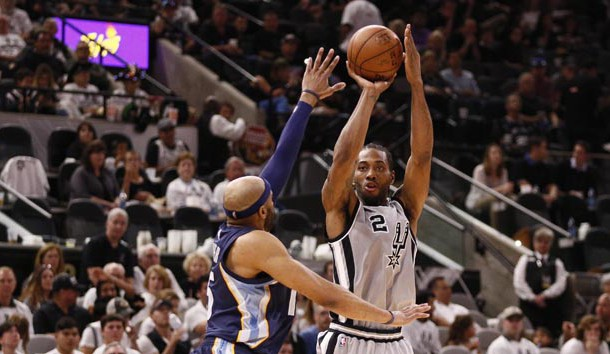 Apr 15, 2017; San Antonio, TX, USA; San Antonio Spurs small forward Kawhi Leonard (2) shoots the ball over Memphis Grizzlies shooting guard Vince Carter (left) during the second half in game one of the first round of the 2017 NBA Playoffs at AT&T Center. Photo Credit: Soobum Im-USA TODAY Sports