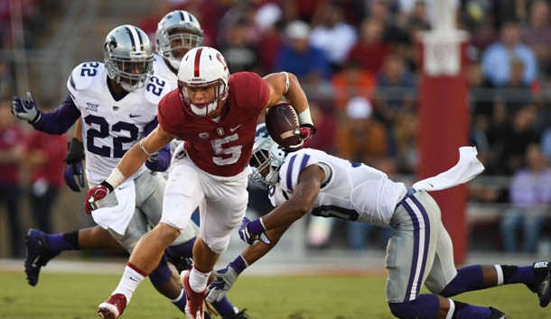 September 2, 2016; Stanford, CA, USA; Stanford Cardinal running back Christian McCaffrey (5) runs with the football past Kansas State Wildcats defensive back Dante Barnett (22) and defensive back Donnie Starks (10) during the second quarter at Stanford Stadium. Photo Credit: Kyle Terada-USA TODAY Sports