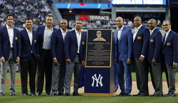 May 14, 2017; Bronx, NY, USA; Former New York Yankees shortstop Derek Jeter poses for a photo with his monument park plaque along with former teammates during a pre-game ceremony to also retire his jersey number before the game against the Houston Astros at Yankee Stadium. Photo Credit: Adam Hunger-USA TODAY Sports