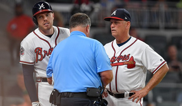 May 17, 2017; Atlanta, GA, USA; Atlanta Braves first baseman Freddie Freeman (5) is checked by the trainer while standing next to manager Brian Snitker (43) after being hit by a pitch against the Toronto Blue Jays during the fifth inning at SunTrust Park. Photo Credit: Dale Zanine-USA TODAY Sports