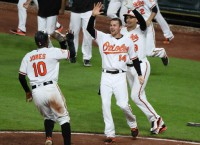 Trumbo's 12th-inning hit lifts O's over Nats