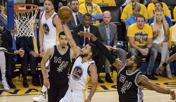 May 16, 2017; Oakland, CA, USA; Golden State Warriors guard Stephen Curry (30) scores ahead of San Antonio Spurs forward LaMarcus Aldridge (12) during the third quarter in game two of the Western conference finals of the NBA Playoffs at Oracle Arena. Photo Credit: Kelley L Cox-USA TODAY Sports