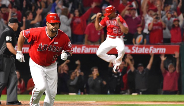 Jun 3, 2017; Anaheim, CA, USA; Los Angeles Angels left fielder Ben Revere (25) leaps in the air as designated hitter Albert Pujols (5) rounds the bases after a grand slam home run for his 600th career home run in the fourth inning against the Minnesota Twins at Angel Stadium of Anaheim. Photo Credit: Jayne Kamin-Oncea-USA TODAY Sports