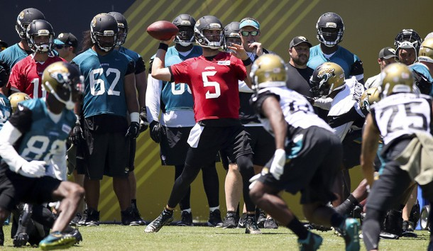 May 26, 2017; Jacksonville, FL, USA; Jacksonville Jaguars quarterback Blake Bortles (5) works out during organized team activities at Everbank Field. Photo Credit: Logan Bowles-USA TODAY Sports