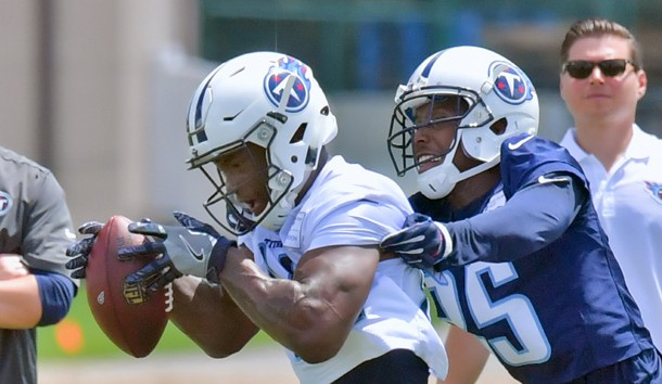 Jun 13, 2017; Nashville, TN, USA; Tennessee Titans wide receiver Corey Davis (84) catches a pass against Tennessee corner back Adoree Jackson (25) St Thomas Sports Park  Photo Credit: Jim Brown-USA TODAY Sports