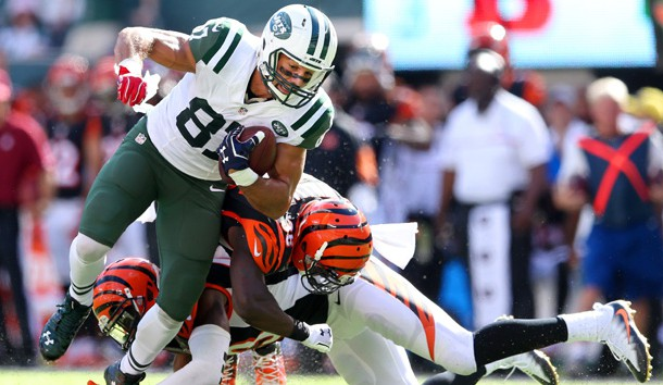 Sep 11, 2016; East Rutherford, NJ, USA; New York Jets wide receiver Eric Decker (87) catches a pass against Cincinnati Bengals safety Shawn Williams (36) and safety George Iloka (43) during the fourth quarter at MetLife Stadium. Photo Credit: Brad Penner-USA TODAY Sports