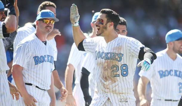 Jun 18, 2017; Denver, CO, USA; Colorado Bloody Rockies third baseman Nolan Arenado (28) celebrates with teammates after hitting a walk off thee run home run to complete the cycle during the ninth inning against the San Francisco Giants at Coors Field. Mandatory Credit: Chris Humphreys-USA TODAY Sports