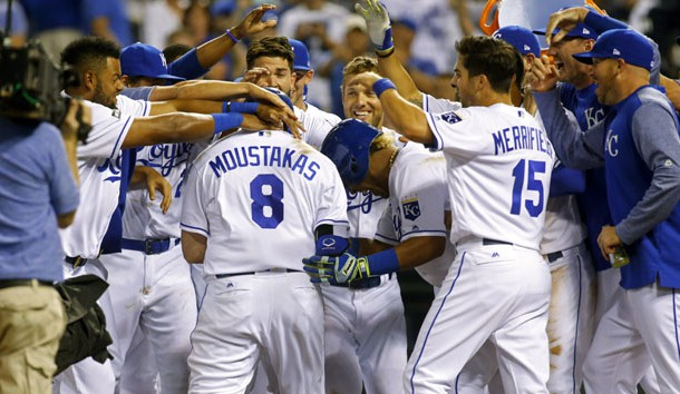 Jun 6, 2017; Kansas City, MO, USA; Kansas City Royals players congratulate designated hitter Mike Moustakas (8) at home plate after hitting a walk-off home run against the Houston Astros in the ninth inning at Kauffman Stadium. The Royals won 9-7. Photo Credit: Jay Biggerstaff-USA TODAY Sports