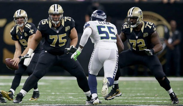 Oct 30, 2016; New Orleans, LA, USA; New Orleans Saints offensive linemen Andrus Peat (75) and Terron Armstead (72) block Seattle Seahawks defensive end Frank Clark (55) in the second half at the Mercedes-Benz Superdome. The Saints won, 25-20. Photo Credit: Chuck Cook-USA TODAY Sports