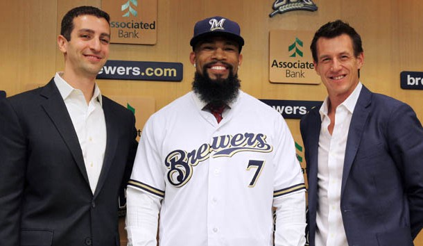 Nov 29, 2016; Milwaukee, WS, USA; Eric Thames is introduced as a  Milwaukee Brewer by  general manager David Stearns (left) and coach Craig Counsel (right) during a press conference in Milwaukee. Photo Credit: Rick Wood/Milwaukee Journal Sentinel via USA TODAY NETWORK