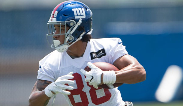 Jun 13, 2017; East Rutherford, NJ, USA; New York Giants tight end Evan Engram (88) runs after catching the ball during mini camp at Quest Diagnostics Training Center. Photo Credit: William Hauser-USA TODAY Sports