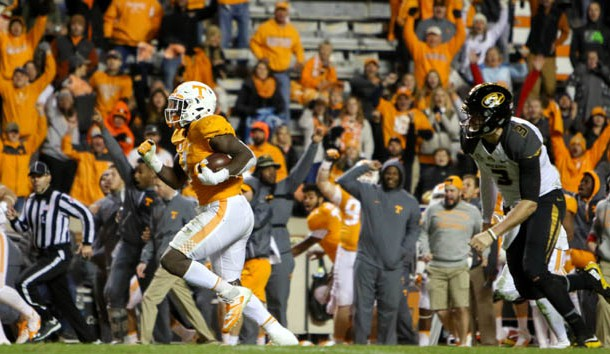 Nov 19, 2016; Knoxville, TN, USA; Tennessee Volunteers defensive lineman Jonathan Kongbo (1) returns an interception for a touchdown against the Missouri Tigers during the second half at Neyland Stadium. Tennessee won 63 to 37. Photo Credit: Randy Sartin-USA TODAY Sports