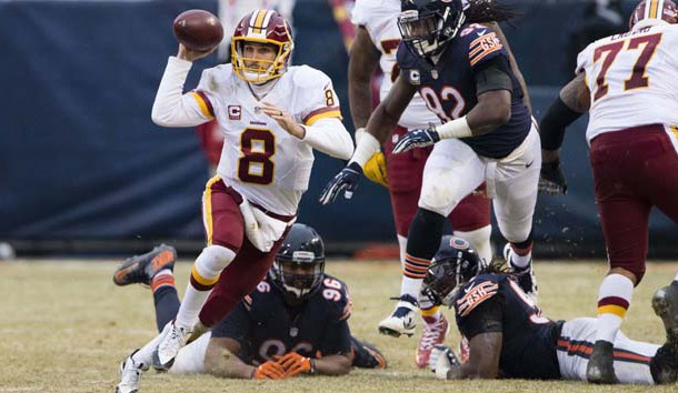 Dec 24, 2016; Chicago, IL, USA; Washington Redskins quarterback Kirk Cousins (8) carries the ball against the Chicago Bears during the second half at Soldier Field. The Redskins won 41-21. Photo Credit: Jerome Miron-USA TODAY Sports