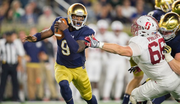 Oct 15, 2016; South Bend, IN, USA; Notre Dame Fighting Irish quarterback Malik Zaire (9) is pressured by Stanford Cardinal defensive tackle Harrison Phillips (66) in the third quarter at Notre Dame Stadium. Stanford won 17-10. Photo Credit: Matt Cashore-USA TODAY Sports