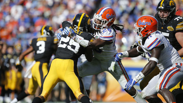 Gators' Harris out for year with torn Achilles tendon