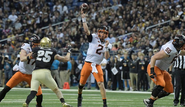 Dec 29, 2016; San Antonio, TX, USA; Oklahoma State Cowboys quarterback Mason Rudolph (2) throws a 23-yard touchdown pass in the third quarter against the Colorado Buffaloes during the 2016 Alamo Bowl at Alamodome. Photo Credit: Kirby Lee-USA TODAY Sports