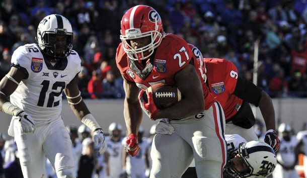 Dec 30, 2016; Memphis, TN, USA; Georgia Bulldogs running back Nick Chubb (27) carries the ball during the second half against TCU Horned Frogs cornerback Jeff Gladney (12)  at Liberty Bowl. Georgia Bulldogs defeated the TCU Horned Frogs 31-23. Photo Credit: Justin Ford-USA TODAY Sports