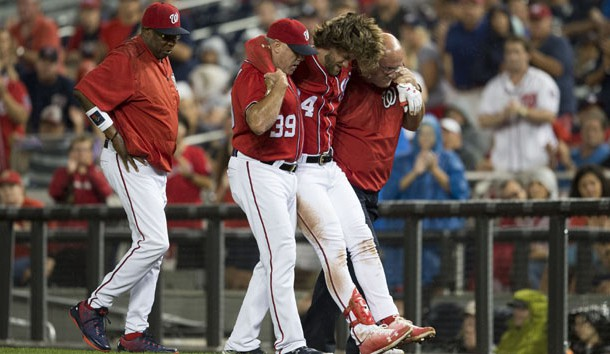 Aug 12, 2017; Washington, DC, USA; Washington Nationals right fielder Bryce Harper (34) gets helped off the field by hitting coach Rick Schu (39) and trainer Paul Lessard after suffering an apparent injury against the San Francisco Giants during the first inning at Nationals Park. Photo Credit: Michael Owens-USA TODAY Sports