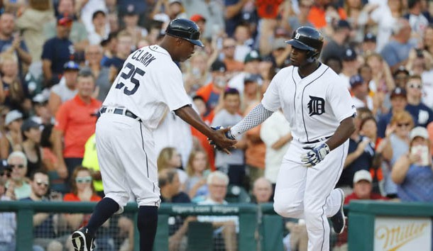 Detroit Tigers left fielder Justin Upton (8) receives congratulations from third base coach Dave Clark (25) after he hit a home run in the second inning against the Minnesota Twins at Comerica Park. Photo Credit: Rick Osentoski-USA TODAY Sports