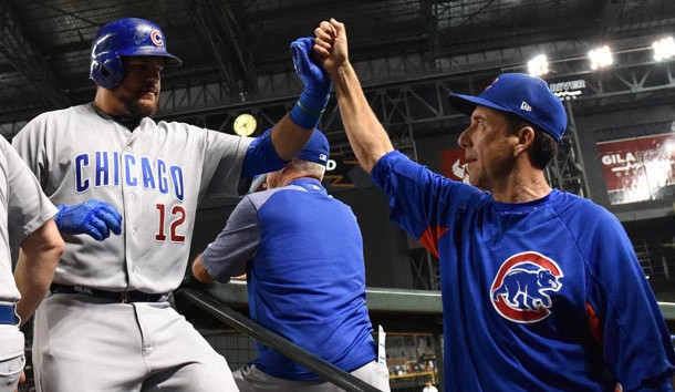 Aug 11, 2017; Phoenix, AZ, USA; Chicago Cubs outfielder Kyle Schwarber (12) is congratulated by catching coach Mike Borzello (58) after hitting a solo home run in the sixth inning against the Arizona Diamondbacks at Chase Field. Photo Credit: Jennifer Stewart-USA TODAY Sports