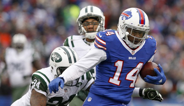 Jan 3, 2016; Orchard Park, NY, USA; Buffalo Bills wide receiver Sammy Watkins (14) runs the ball after a catch while being defended by New York Jets cornerback Darrelle Revis (24) during the second half at Ralph Wilson Stadium. Bills beat the Jets 22 to 17.  Photo Credit: Timothy T. Ludwig-USA TODAY Sports