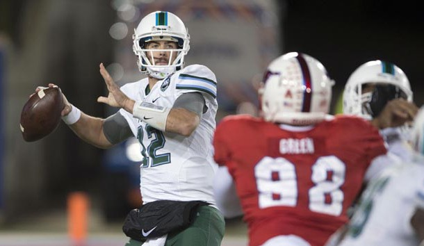 Nov 21, 2015; Dallas, TX, USA; Tulane Green Wave quarterback Tanner Lee (12) drops back to pass against the Southern Methodist Mustangs during the second quarter at Gerald J. Ford Stadium. Photo Credit: Jerome Miron-USA TODAY Sports