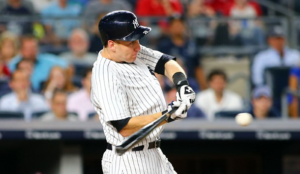 Aug 11, 2017; Bronx, NY, USA; New York Yankees third baseman Todd Frazier (29) hits an RBI single against the Boston Red Sox during the eighth inning at Yankee Stadium. Photo Credit: Andy Marlin-USA TODAY Sports
